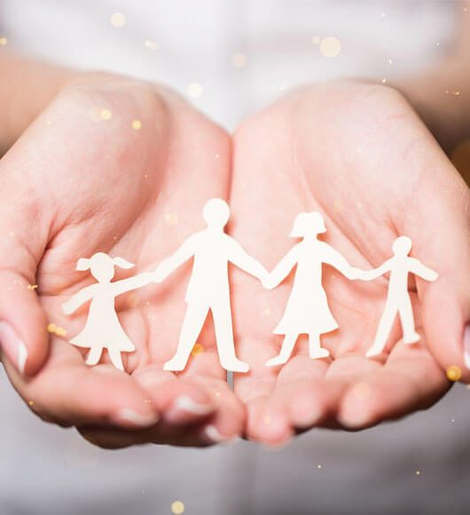 family cut out on palms of hands
